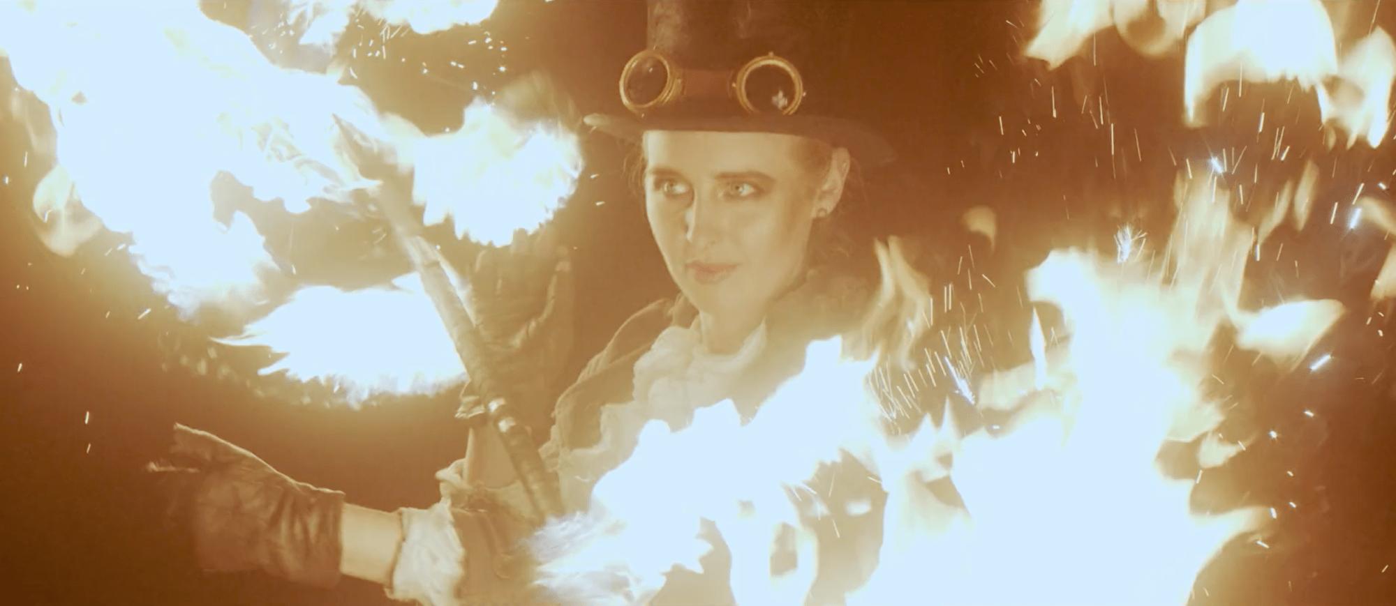Elddansare i steampunk kläder